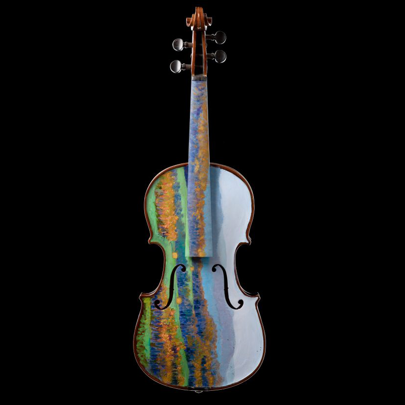 A violin painted with an Appalachian mountain scene against a black background.